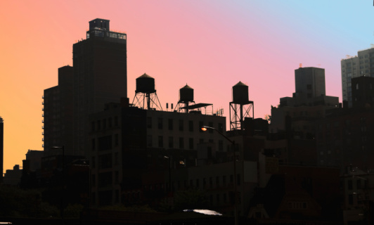 Smog「Rooftops with water tanks in silhouette against colorful sky」:スマホ壁紙(14)