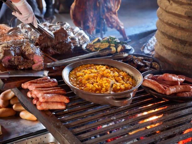 Taditional asado at a ranch in Patagonia, Chile:スマホ壁紙(壁紙.com)