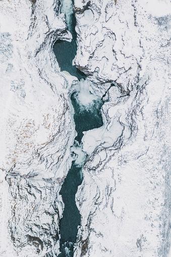 Dramatic Landscape「Scenic aerial view of Koluglufur waterfall in winter」:スマホ壁紙(0)