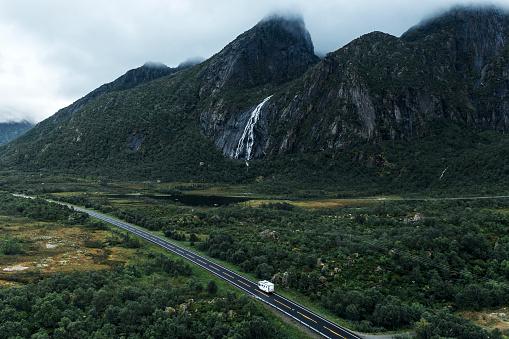Steep「Scenic aerial view of camper van near waterfall on  road in Norway」:スマホ壁紙(1)