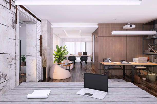 Small contemporary office interior with large office desk with open laptop:スマホ壁紙(壁紙.com)