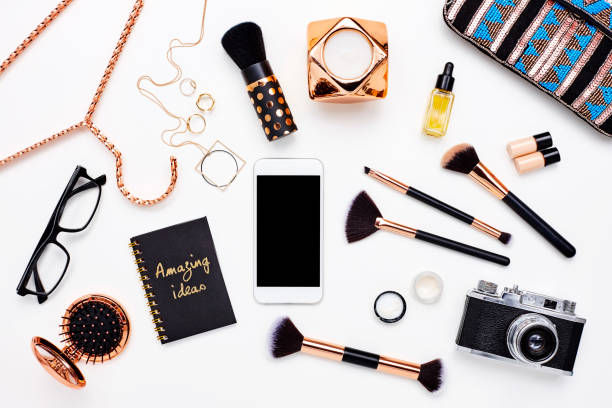 Smart phone surrounded with beauty products on white background:スマホ壁紙(壁紙.com)