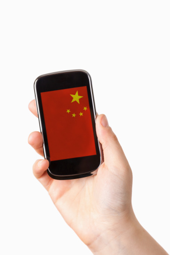 Unrecognizable Person「Smart phone with the flag of China」:スマホ壁紙(12)