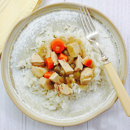 Basmati Rice「Chicken fricassee on a handmade plate with antique fork and napkin」:スマホ壁紙(8)