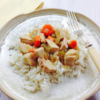 Basmati Rice「Chicken fricassee on a handmade plate with antique fork and napkin」:スマホ壁紙(13)