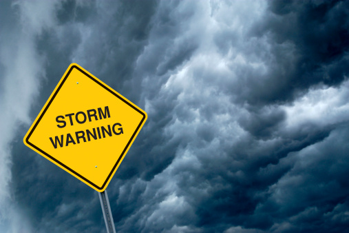 Thunderstorm「A yellow storm warning sign with storm clouds behind 」:スマホ壁紙(4)