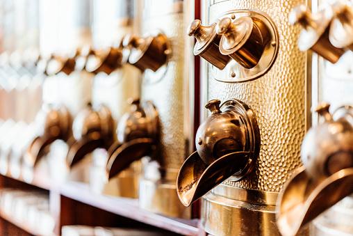 Coffee Roaster「Row of brass coffee dispensers」:スマホ壁紙(8)