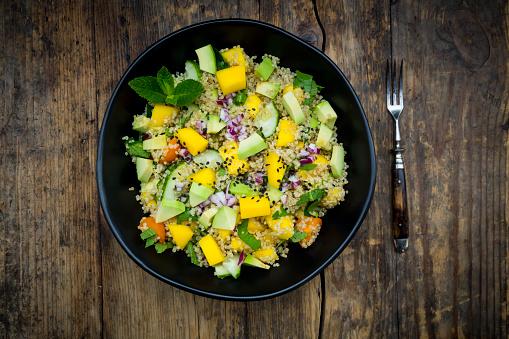 Mint Leaf - Culinary「Bowl of quinoa salad with mango, avocado, tomatoes, cucumber, herbs and black sesame」:スマホ壁紙(1)