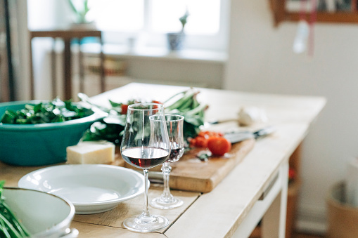 Kitchen Counter「Wineglasses on kitchen island at home」:スマホ壁紙(11)