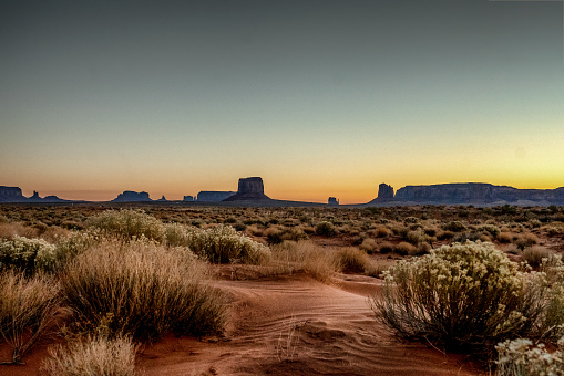 Indian Subcontinent Ethnicity「Dawn at Monument Valley Tribal Park with Beautiful Desert Sand in Front of the Majestic Mitten Bluffs of the Tribal Park」:スマホ壁紙(0)