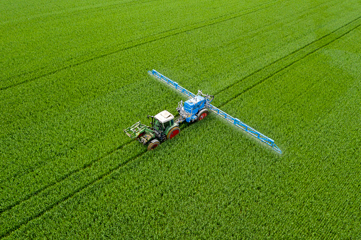 Crop - Plant「Tractor spraying wheat field, aerial view」:スマホ壁紙(1)