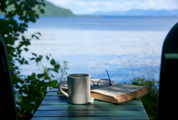 Hot beverage ,book, eyeglasses, and a incredible view of Moosehead lake and Mount Kineo in Maine, USA:スマホ壁紙(壁紙.com)