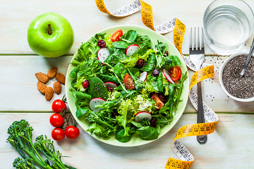 Arugula「Healthy eating and dieting concepts: Fresh healthy salad, fruits and tape measure」:スマホ壁紙(1)
