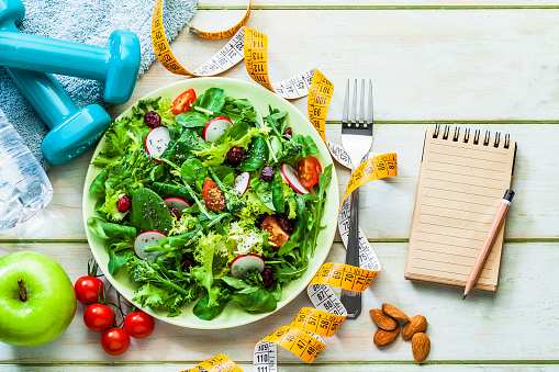 Arugula「Healthy eating and exercising concepts: Fresh healthy salad, dumbbells and tape measure」:スマホ壁紙(2)