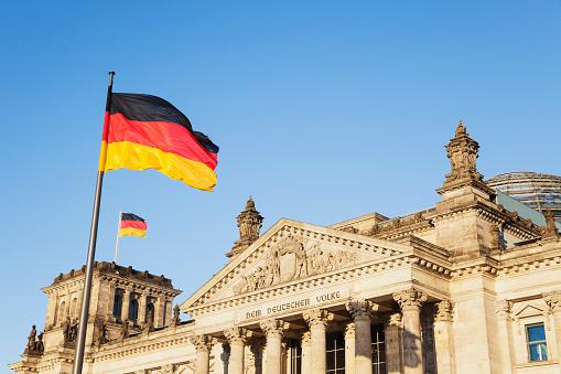 The Reichstag「Germany, Berlin, Regierungsviertel, Reichstag building with German Flags」:スマホ壁紙(12)