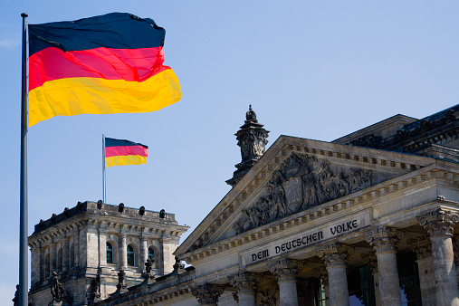 The Reichstag「Germany, Berlin, view to upper part of Reichstag building with two German flags」:スマホ壁紙(10)