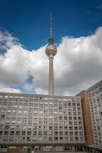 Unrecognizable Person「Germany, Berlin, view to television tower with concrete tower block in the foreground」:スマホ壁紙(0)