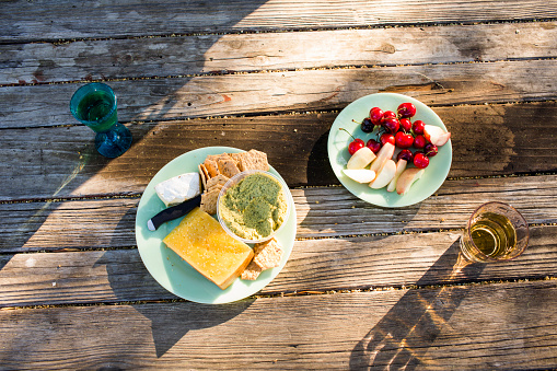 Picnic「Plates of cheese and fruit on wooden table」:スマホ壁紙(18)