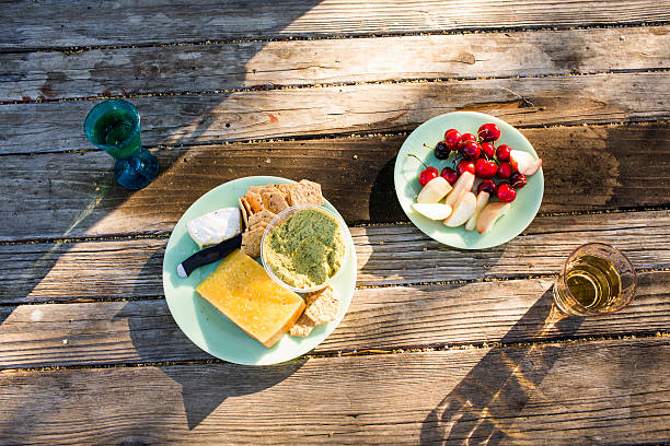 Plates of cheese and fruit on wooden table:スマホ壁紙(壁紙.com)