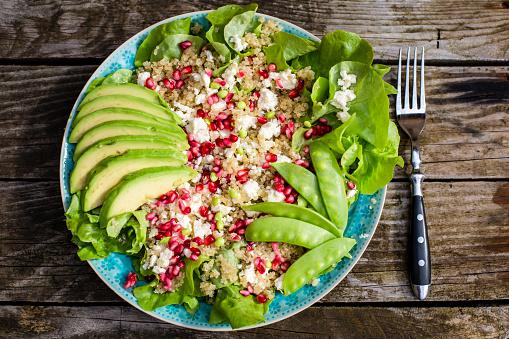 Middle Eastern Food「Quinoa salad with feta, pomegranate, avocado and snow peas on plate」:スマホ壁紙(2)