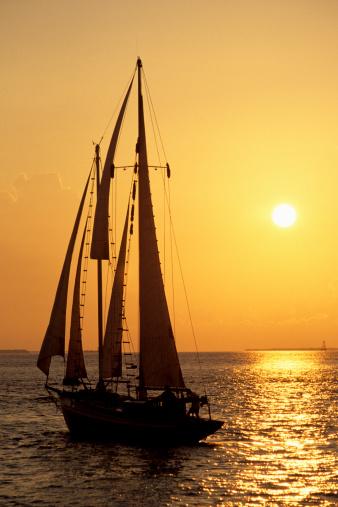Miami Beach「Sailboat sailing in golden sunset light, Miami, FL」:スマホ壁紙(3)