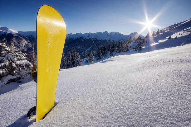 Yellow snowboard in snow on mountain:スマホ壁紙(壁紙.com)