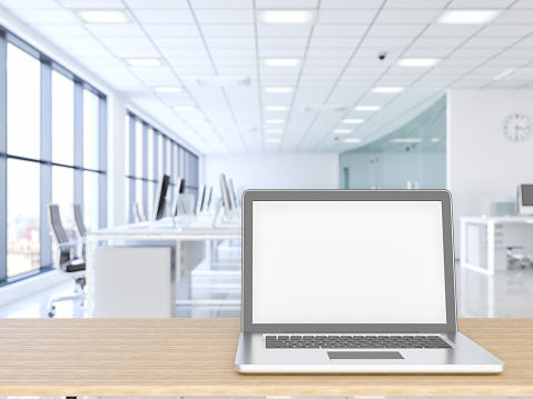 Place of Work「Laptop with wood empty surface and office building as background」:スマホ壁紙(0)
