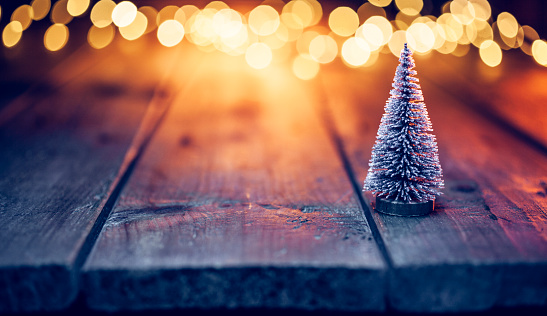 Christmas Decoration「Christmas tree on old wood and defocused blue gold lights」:スマホ壁紙(14)