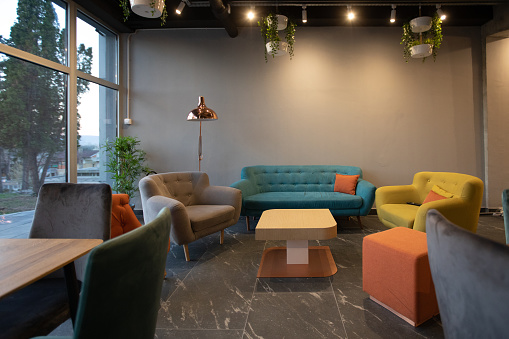 New Business「Sofa and armchair in modern cafeteria」:スマホ壁紙(13)