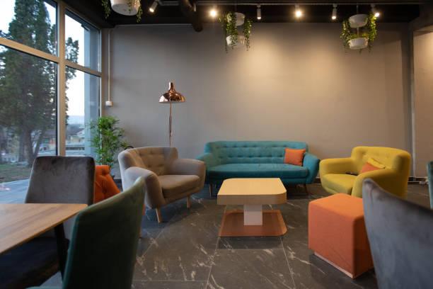 Sofa and armchair in modern cafeteria:スマホ壁紙(壁紙.com)