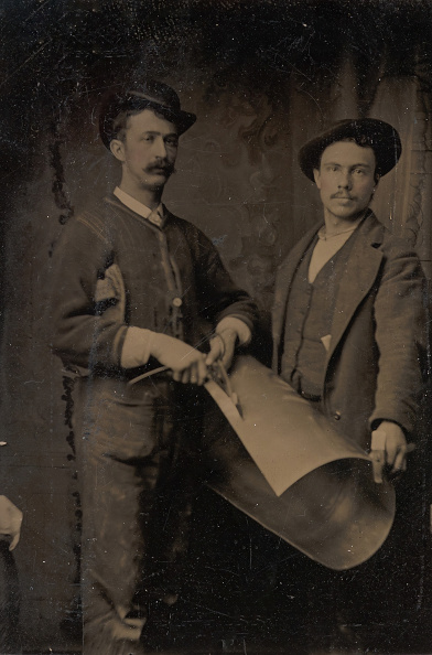 Curled Up「Two Tinsmiths Cutting A Curled Sheet Of Metal」:写真・画像(6)[壁紙.com]
