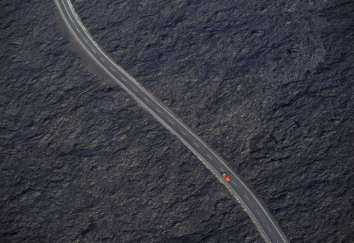 Volcanic Landscape「Car on road in lava field, overhead view (Digital Composite)」:スマホ壁紙(2)