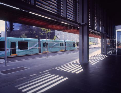Melbourne Docklands「Stylish tram arriving at modern office district」:スマホ壁紙(2)