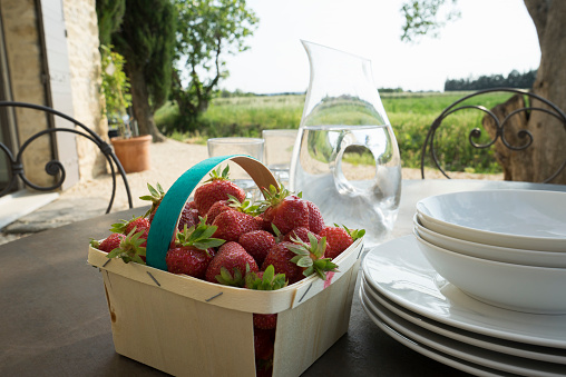 Back Lit「Table setting on a farm in France with late afternoon light and fresh strawberries」:スマホ壁紙(3)