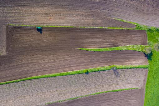Plowed Field「Tractor on field, aerial view」:スマホ壁紙(2)