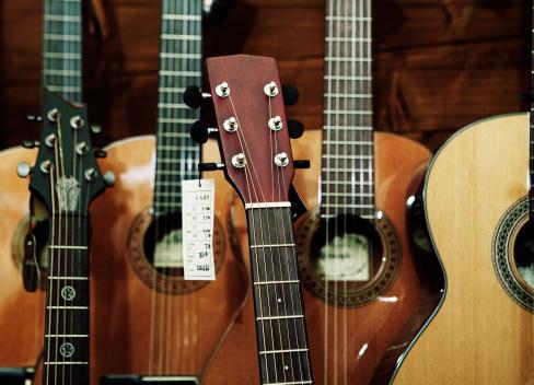 Guitar「different classic guitars in a shop」:スマホ壁紙(7)