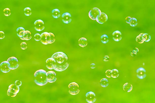 Close up Floating Bubbles  on green background in summer:スマホ壁紙(壁紙.com)