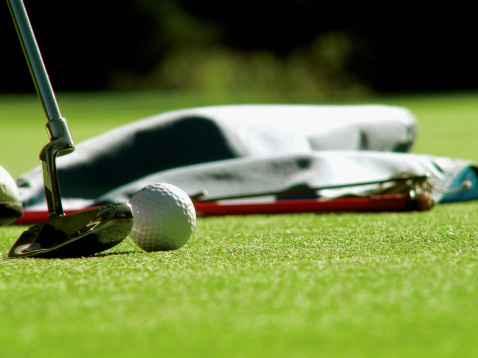 Putting - Golf「Golf ball and putter, with golf flag down, extreme close-up, selective focus」:スマホ壁紙(4)