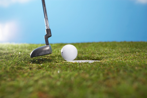 Putting - Golf「Golf ball and putter on edge of hole, close up」:スマホ壁紙(0)
