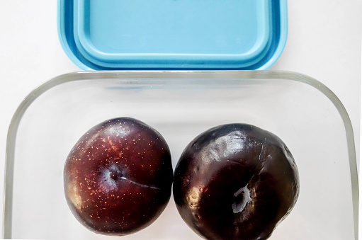 Plum「Two Ripe Plums in a Glass Storage Container」:スマホ壁紙(5)