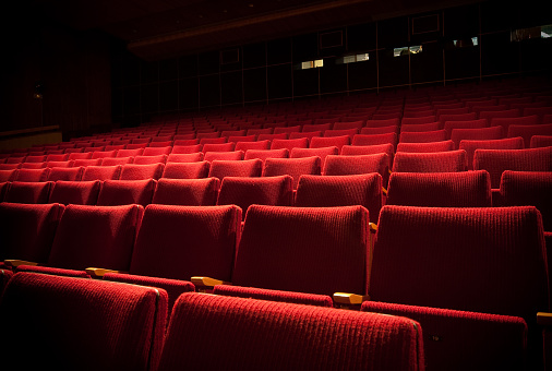 Lounge Chair「Empty theatre with red seats in low light」:スマホ壁紙(5)