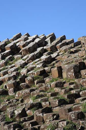 Basalt「Giant's Causeway basalt columns against blue sky. N. Ireland.」:スマホ壁紙(9)
