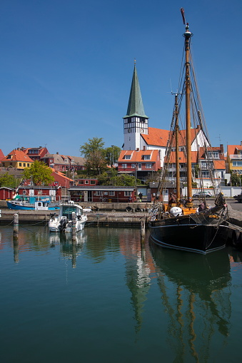 Danish Culture「Fishing boats and dinghies in harbor with church behind, Ronne, Bornholm, Denmark」:スマホ壁紙(12)