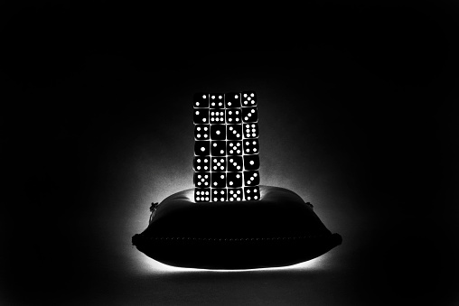 North Holland「Stack of dice in the dark with light from within.」:スマホ壁紙(19)