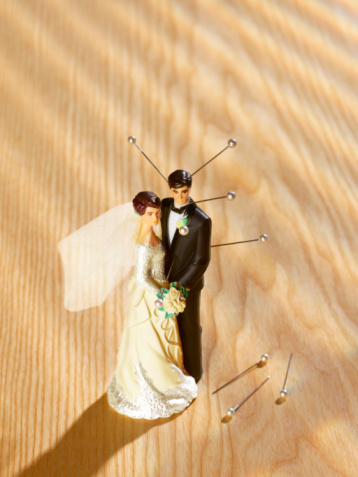 Furious「Bride and groom figurine with sticking out pins, high angle view」:スマホ壁紙(10)