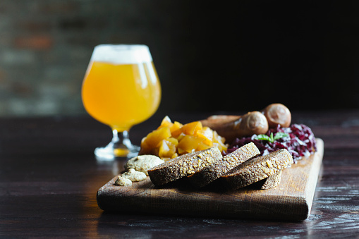 Sausage「Bread, fruit and cheese on cutting board with beer」:スマホ壁紙(8)