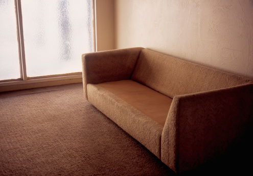 Unrecognizable Person「Couch with no cushions in empty living room」:スマホ壁紙(0)