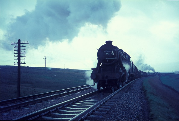 Finance and Economy「Ex LMS Stanier 8F No.48735 makes an assault on the legendary Shap Bank during a rain storm with a northbound mixed freight. The train is hauled by a BR Standard 4 Class 4-6-0 NO.75032. Wednesday 27th September 1967.」:写真・画像(11)[壁紙.com]