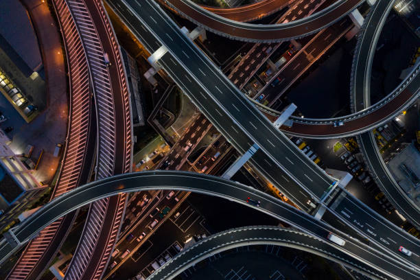 Night photograph of complicated intersecting highway.:スマホ壁紙(壁紙.com)