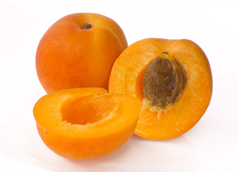 Discovery「Two apricots with one cut in half to reveal stone」:スマホ壁紙(6)
